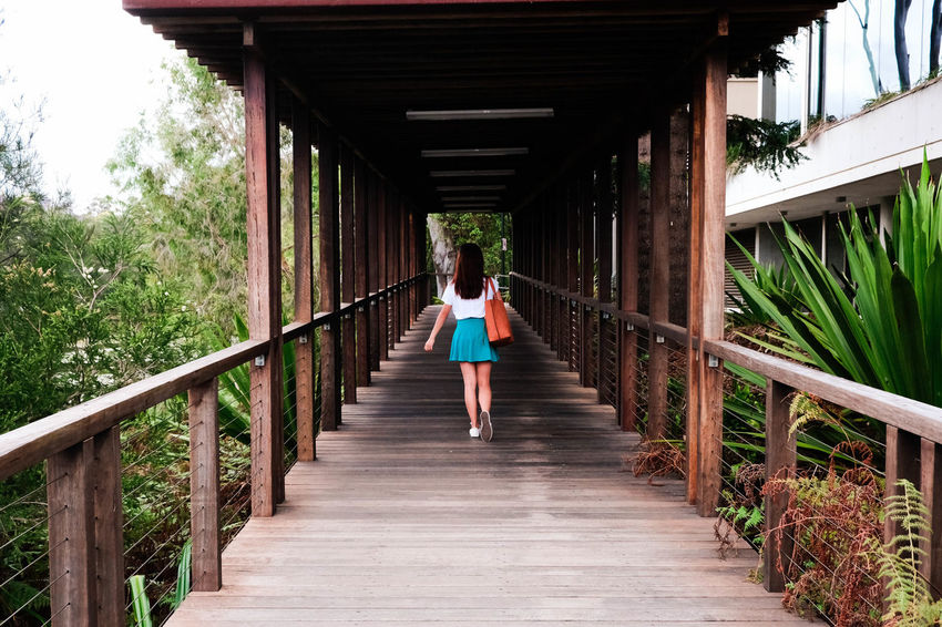 Adult Adults Only Architectural Column Architecture Bridge - Man Made Structure Built Structure Day Exercising Footbridge Full Length Leisure Activity Lifestyles Nature One Person Outdoors People Real People The Way Forward Tree Young Adult Young Women