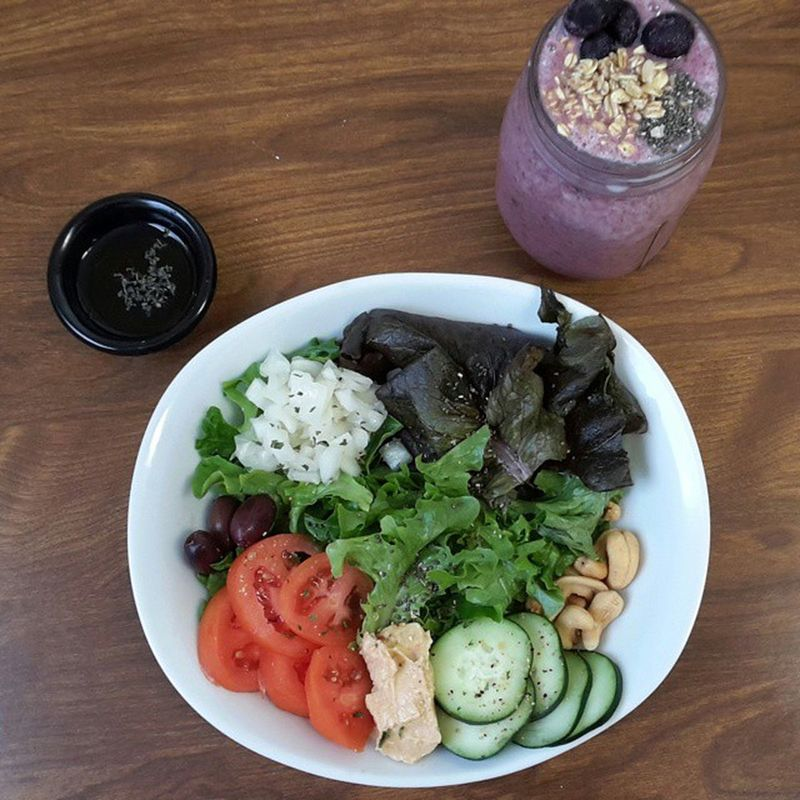 Salad, homemade vinaigrette, strawberry smoothie topped with blueberries, granola, and chia seeds. Veganfoodshare Vegansofig Vegan VEGANLIFE Vegangirl Veganfoodporn Whatveganseat Eatyourcolors EatTheRainbow Eattolive Healthychoices Healthyfoodchoices Smoothies Salad Healwithfood Nourishyoursoul NourishAndHeal Fitspiration Fitmom Fitfam