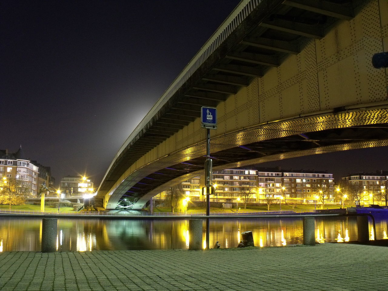 illuminated, night, architecture, built structure, river, water, railing, bridge - man made structure, building exterior, reflection, travel destinations, city, outdoors, no people, modern, sky, futuristic