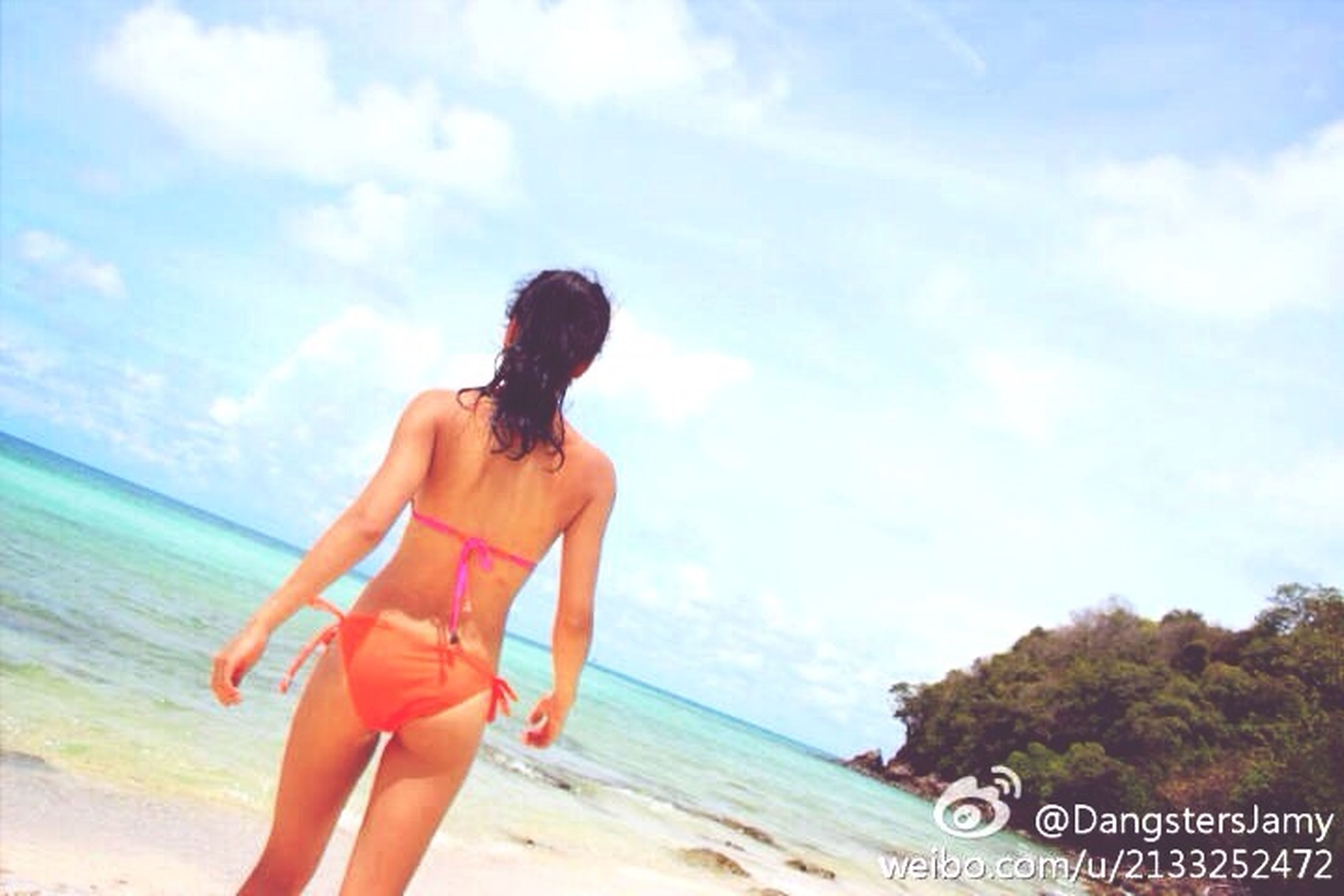 beach, sea, sky, horizon over water, lifestyles, shore, water, leisure activity, sand, young women, young adult, person, rear view, full length, cloud - sky, standing, vacations, nature