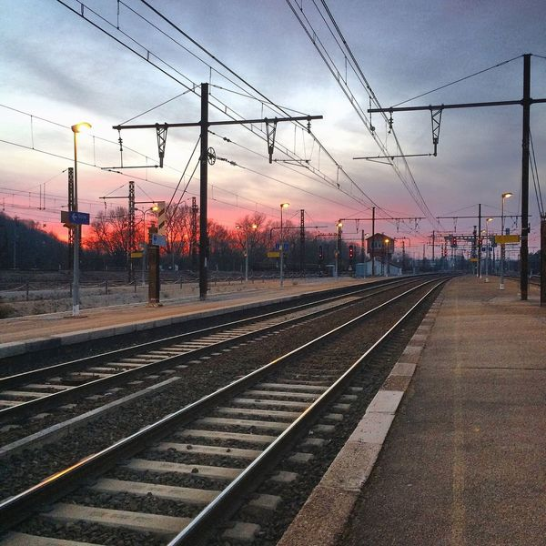 Train... Railroad Track Transportation Sky Rail Transportation Cable Power Line  Railroad Station Electricity Pylon Power Supply Electricity  Public Transportation Railroad Station Platform Outdoors No People Built Structure Day Tree Train Station Architecture