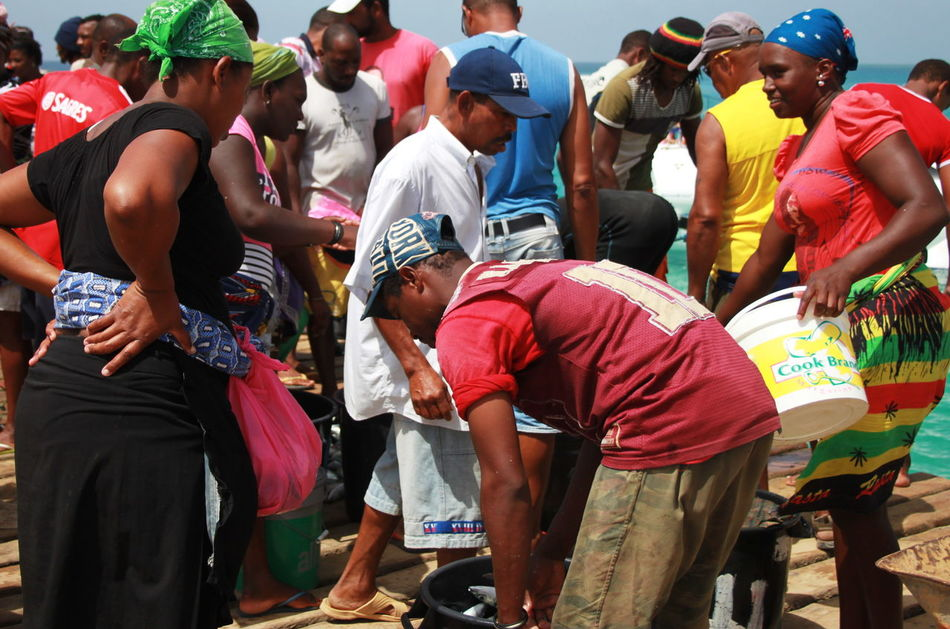 Capo Verde Day Fish Market Large Group Of People Lifestyles Men Multi Colored Outdoors People Real People Sal Island Santa Maria Sea Standing Summer 2015 Tradition Water Women Wooden Pier