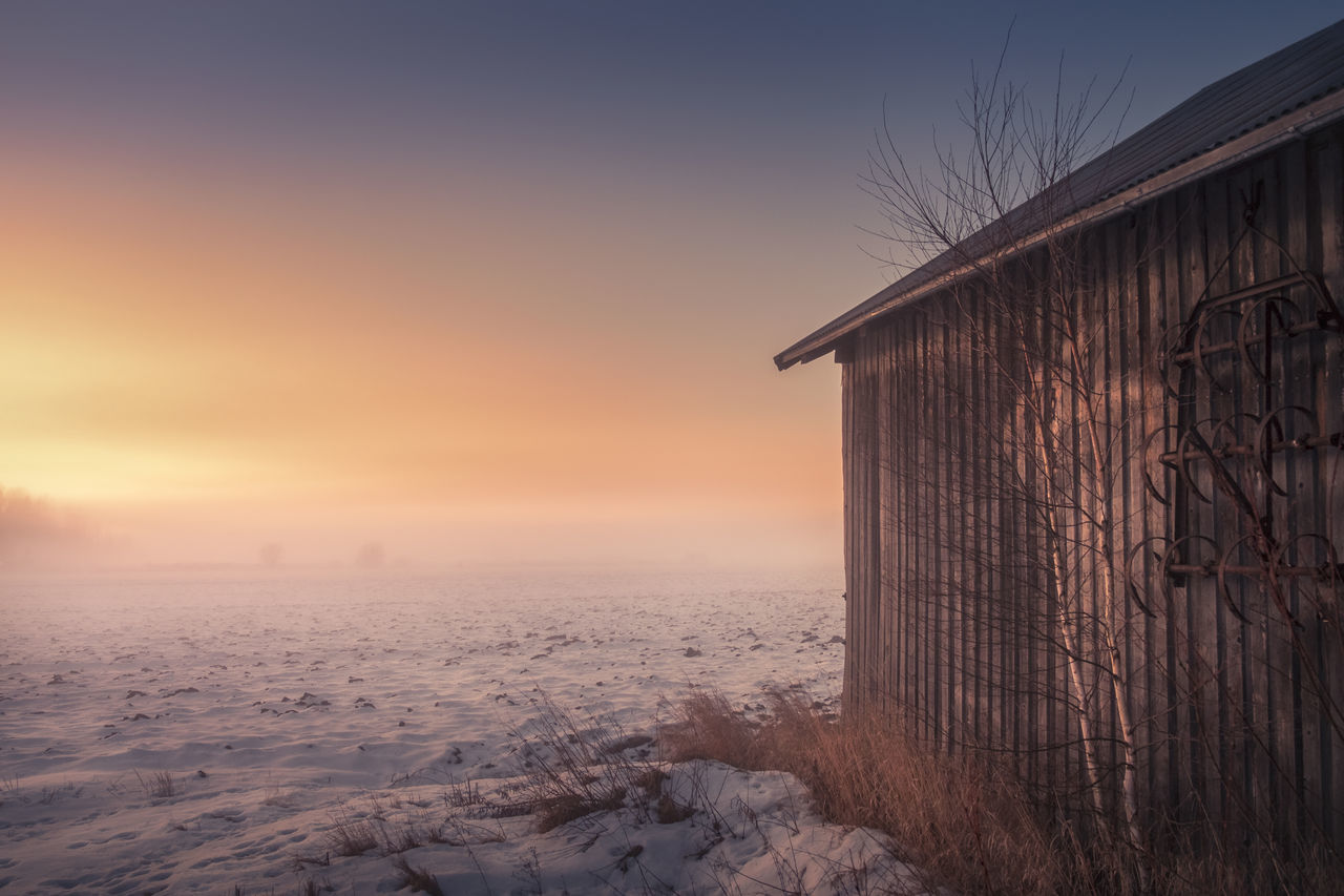 Landscape with old cottage and sunset at winter time in southern Finland Atmospheric Mood Beauty In Nature Built Structure Cold Temperature Color Colorful Cottage Countryside Evening Farm Fog Foggy Frost Light And Shadow Mist Nature No People Outdoors Peaceful Sky Snow Sunset Winter Winter Wooden