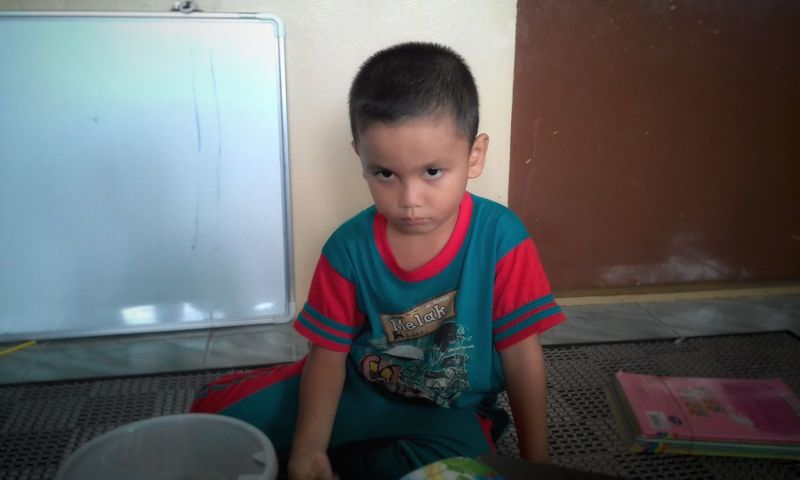 Hi HI Lovehim Shocked Face One Person Child Front View Childhood Indoors  Boys Casual Clothing People One Boy Only Looking At Camera Domestic Life Sitting Portrait Lifestyles Day EyeEmNewHere Malaysia