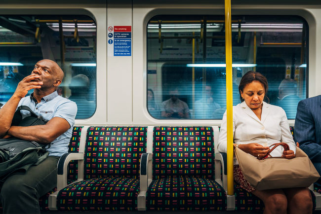 Adult Adults Only Commuter Day London Lifestyle Mature Adult Mature Men Men On The Move Only Men Passenger People Public Transportation Senior Men Sitting Subway Train Transportation Two People Vehicle Interior