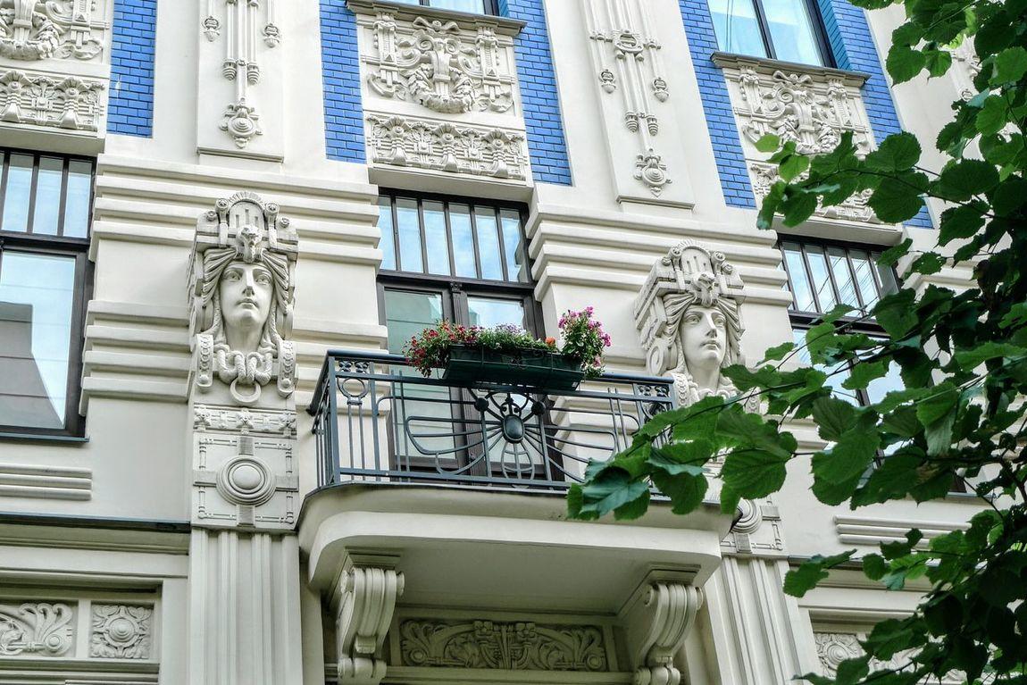 Art Nouveau architecture in Riga, Latvia Art Nouveau Architecture House Building Façade Façade Harmony Balcony Flowers Tree Green Leaves Branch Blue Blue And Gray Latvia Riga Balticum Baltic Countries Harmony Figure