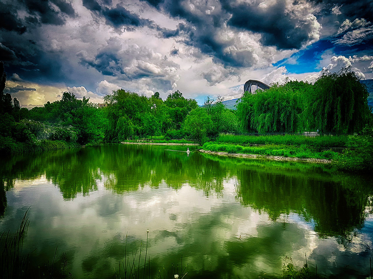 reflection, water, cloud - sky, tree, lake, sky, nature, waterfront, beauty in nature, tranquil scene, no people, green color, tranquility, outdoors, scenics, day