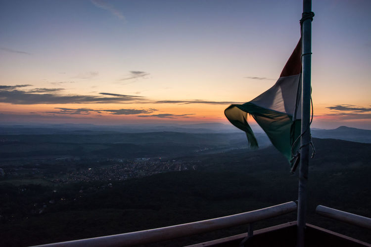 Sunset from Piliscsaba with a Hungarian flag Dusk Flag Hungarian Flag Hungary Outdoors Silhouette Sky Sunset Tranquility Vire