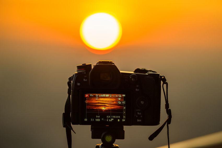 Panasonic G9 G9 Panasonic  Camera Camera - Photographic Equipment Close-up Digital Camera Focus On Foreground Orange Color Photographing Photography Themes Sun Sunset Technology