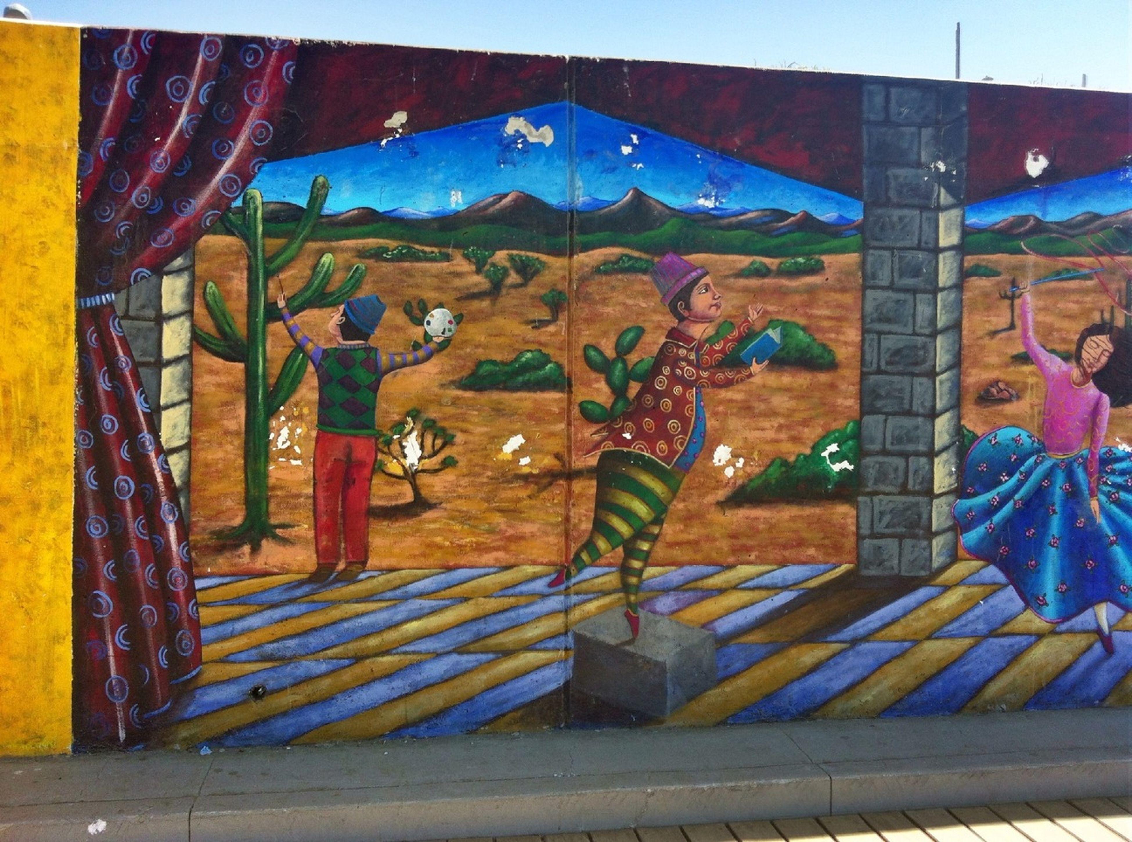 art, art and craft, creativity, graffiti, built structure, architecture, building exterior, human representation, blue, animal representation, sunlight, multi colored, sculpture, wall - building feature, shadow, day, street art, outdoors, statue
