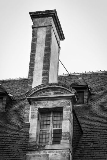 Roof detail of a historical building in Bayeux Architectural Detail Architectural Feature Architecture Architecture Bayeux Building Exterior Built Structure Chimney Clear Sky Day Detail Exterior Façade Historic History Low Angle View No People Outdoors Roof Sky Tall Tall - High The Past