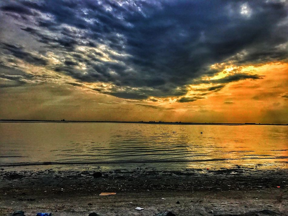 Cloud - Sky Water Sky Scenics Beauty In Nature Nature Sea Sunset Tranquil Scene Tranquility Reflection Outdoors Beach No People Horizon Over Water Day