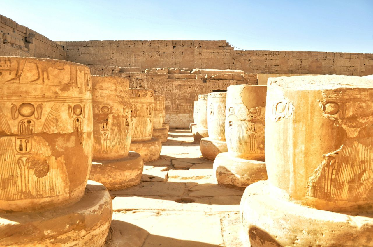 history, ancient, old ruin, archaeology, ancient civilization, the past, built structure, travel destinations, architecture, stone material, tourism, shadow, sunlight, architectural column, travel, outdoors, rock - object, day, sky, sculpture, no people, building exterior, king - royal person