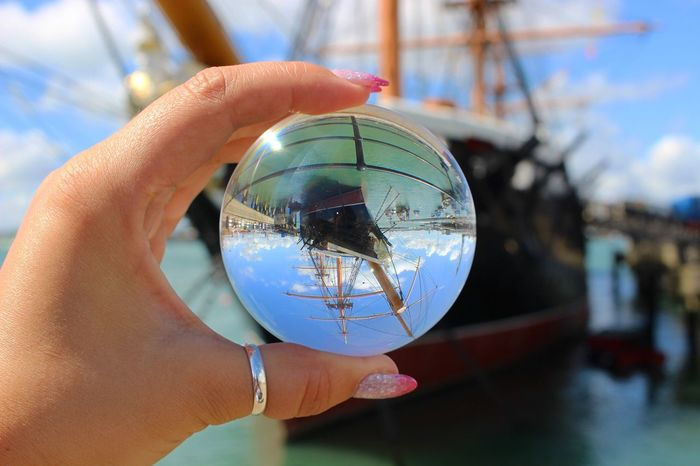 Human Hand Sphere Glass - Material Human Finger Real People Human Body Part Holding Close-up Focus On Foreground Reflection Crystal Ball One Person Built Structure Architecture Day Sky Indoors  Building Exterior People