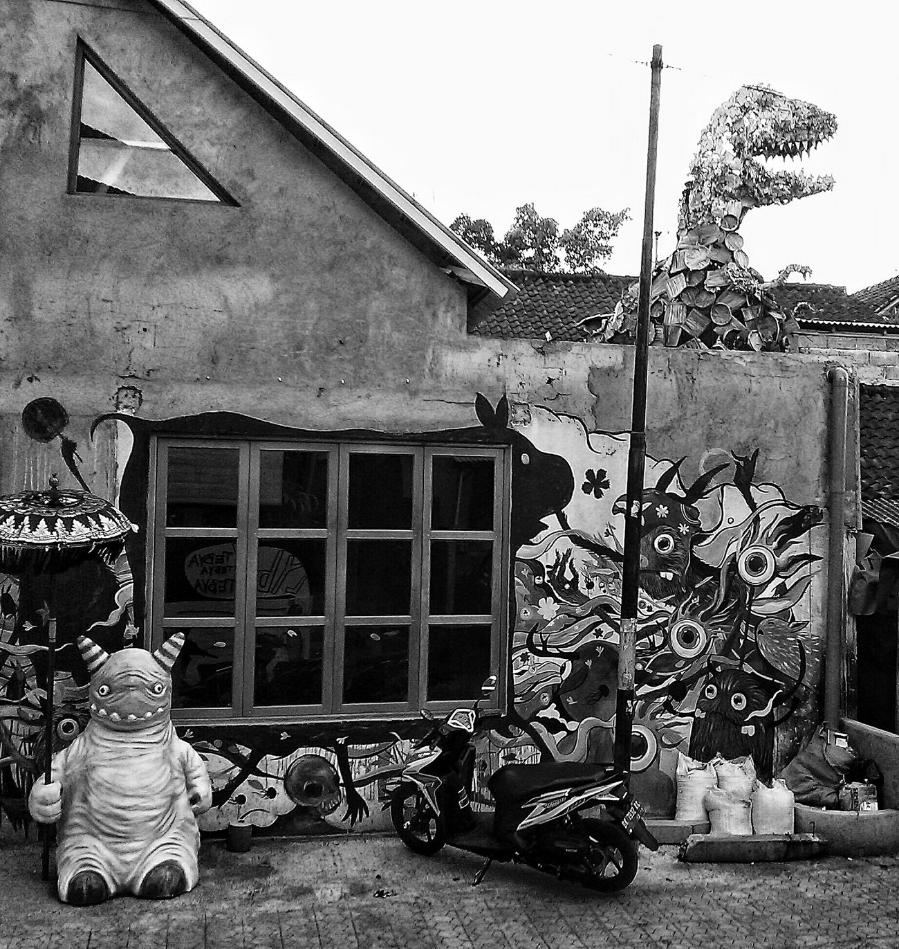 T-rex and his friends.. Streetphoto_bw Urbanphotography Streetart Urban Art Monochrome Ubud INDONESIA
