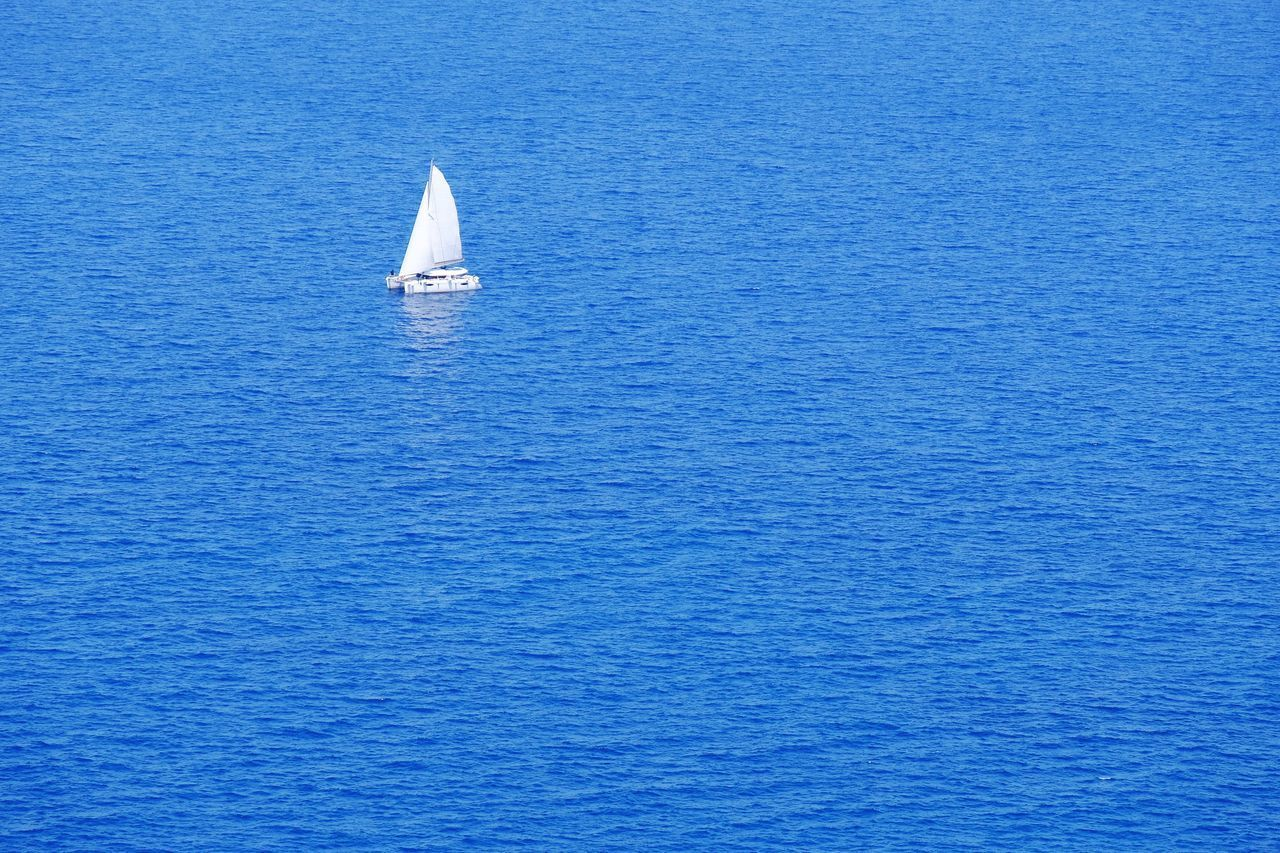 Sea Sailboat Sailing Water Blue Nautical Vessel Transportation Journey Yacht Day Outdoors Nature No People Vacations Beauty In Nature Sailing Ship Yachting Catamaran Summer Hollidays EyeEm Best Shots EyeEm Gallery Check This Out in Santorini , Greece MISSIONS: The Great Outdoors - 2017 EyeEm Awards