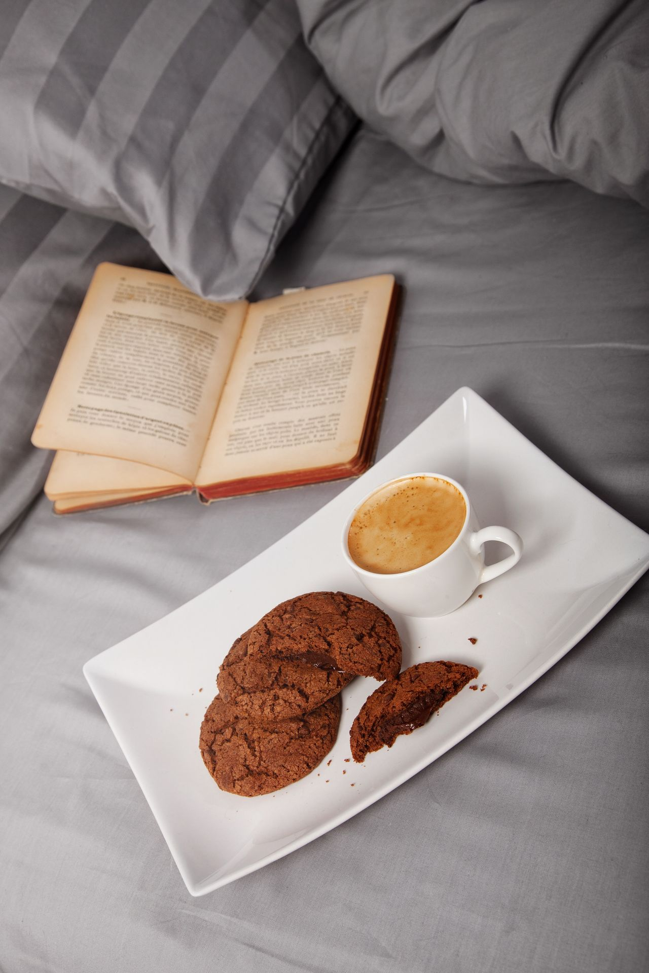 Coffee in bed Coffee - Drink Food And Drink Coffee Cup Indoors  High Angle View Bedroom Drink Book Plate Warm Indoors  Food Close-up Bed Always Be Cozy Relaxation Blanket Linen Pillow Morning Cocooning Espresso Cup Chocolate Cookies