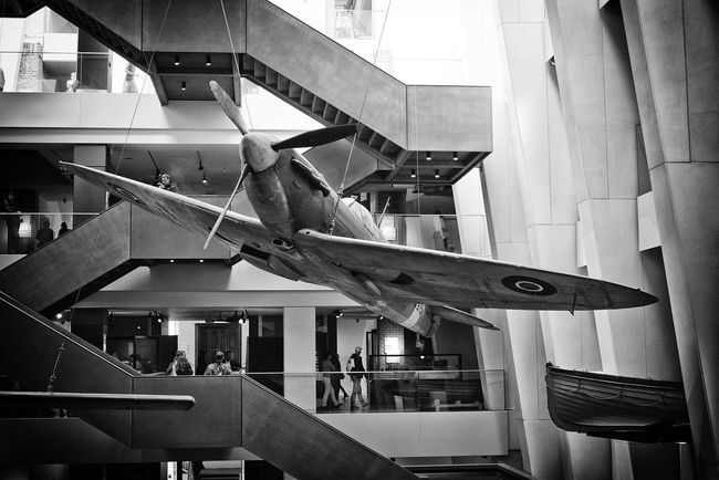 Straight lines of architecture against curved shape of Spitfire. Aircraft Architecture Black And White Black And White Photography Blackandwhite Blackandwhite Photography Bnw_friday_eyeemchallenge Built Structure Imperial War Museum London London Spitfire Urban Lines And Shapes
