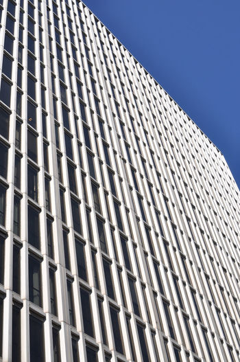 High ri.se building with many windows Apartment Buildings Architecture Backgrounds Blue Blue Sky Building Built Structure City Day Design Exterior Full Frame Geometric Shape High Rise Building Low Angle View Modern No People Office Building Outdoors Pattern Repetition Sky Tall - High White Windows