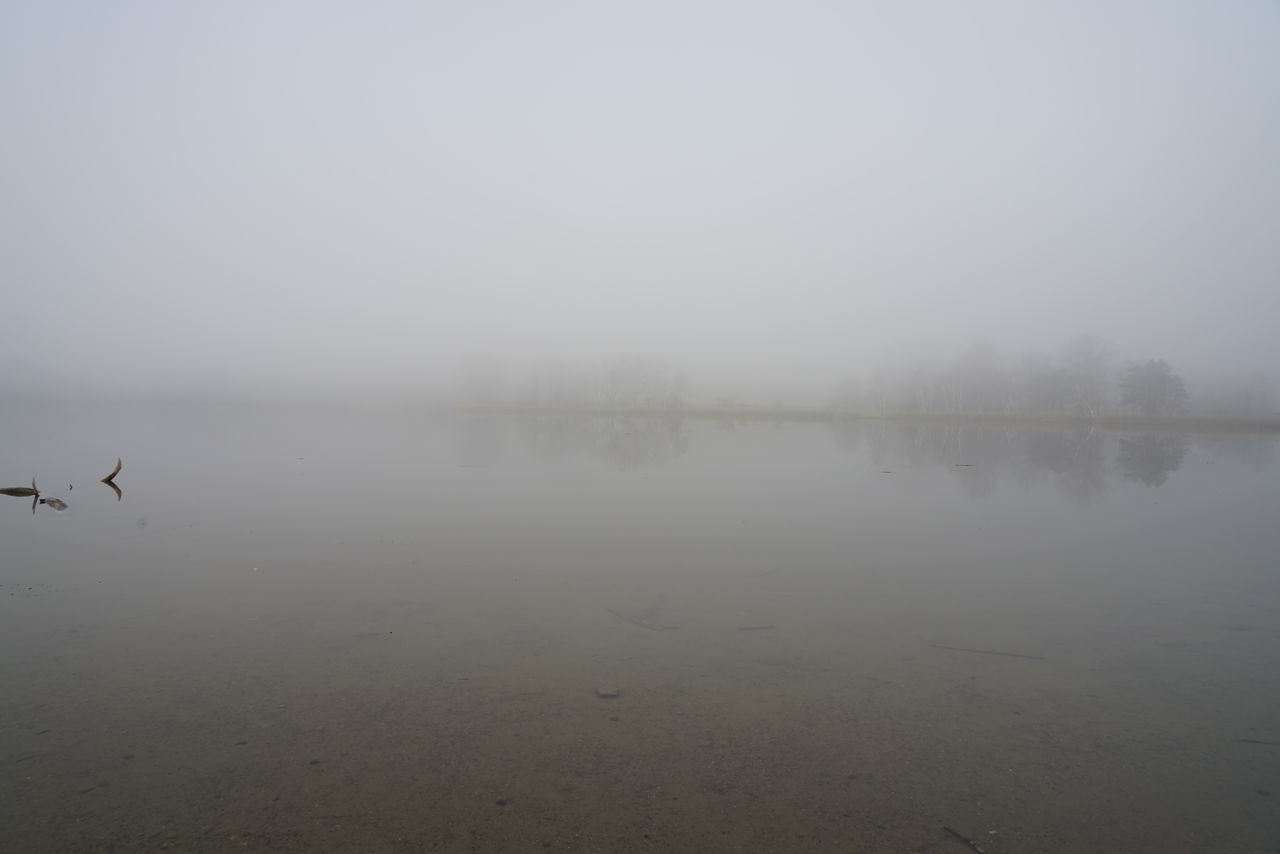 water, tranquility, reflection, nature, tranquil scene, fog, beauty in nature, scenics, outdoors, idyllic, mist, lake, no people, hazy, day, sky