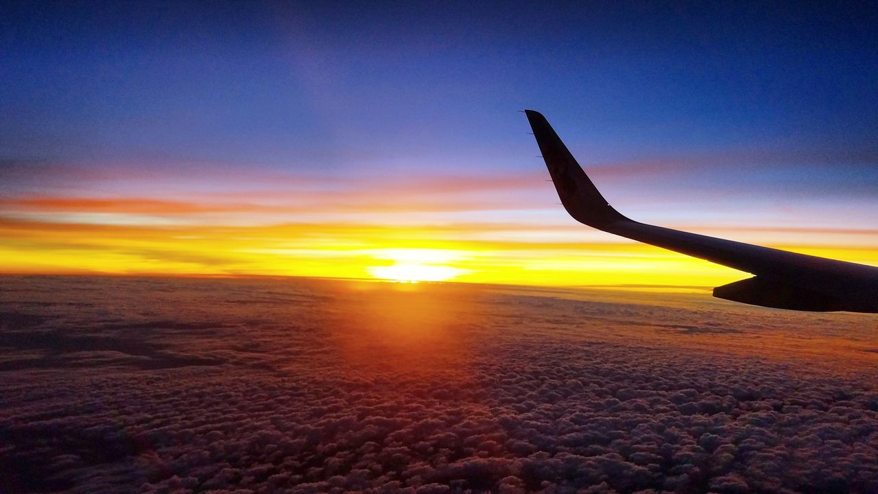 sunset, sky, airplane, scenics, beauty in nature, nature, sun, transportation, mode of transport, cloud - sky, no people, air vehicle, aircraft wing, tranquil scene, flying, outdoors, travel, journey, tranquility, silhouette, airplane wing, sunlight, sea, horizon over water, close-up, day