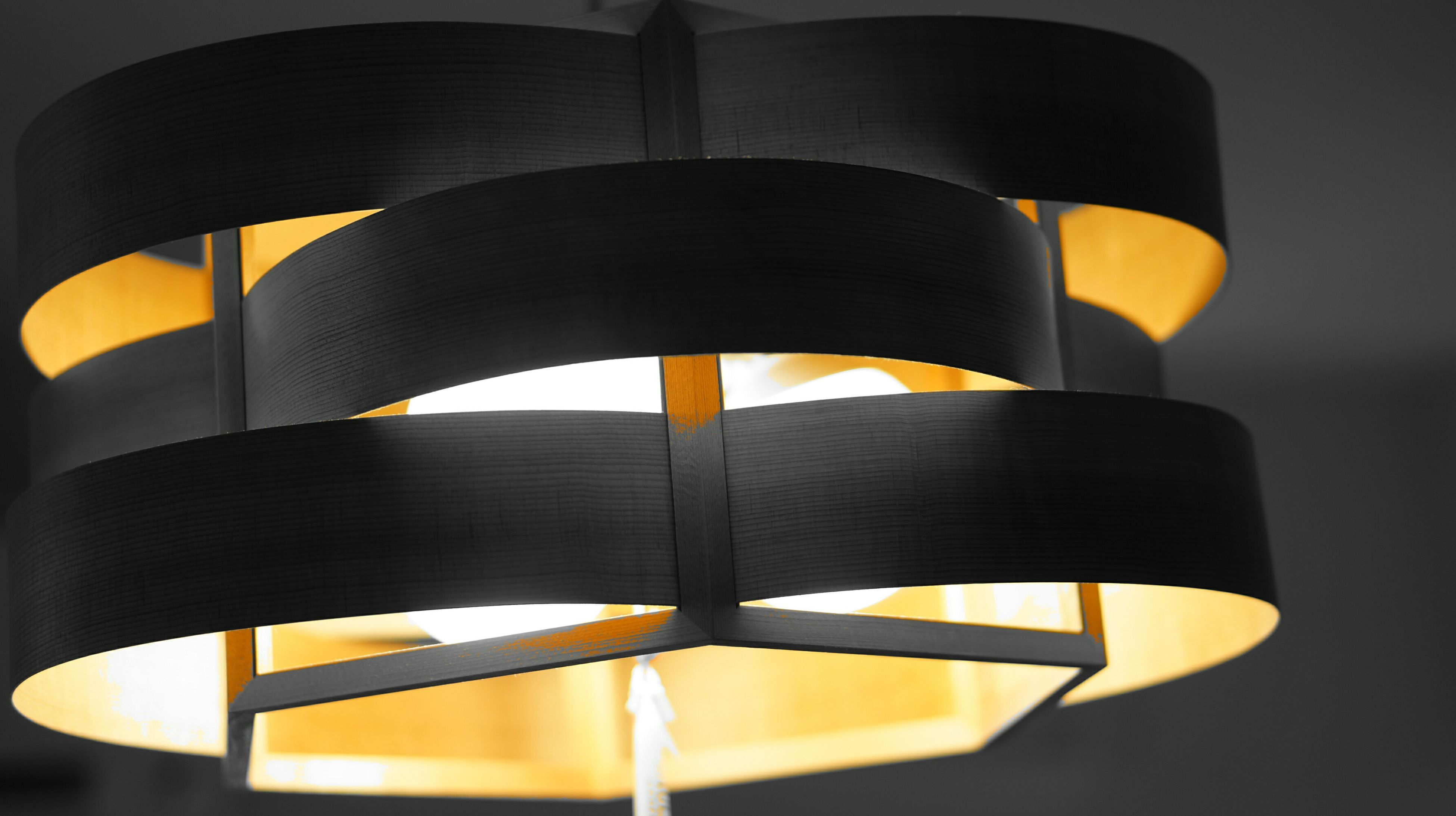 yellow, indoors, pattern, close-up, circle, multi colored, design, no people, still life, metal, orange color, geometric shape, in a row, shape, single object, sunlight, illuminated, repetition, wood - material, protection