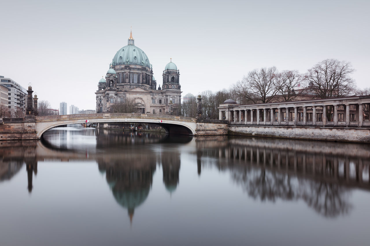 Berlin Cathedral on a grey winter morning Architecture Berlin Berlin City Bridge - Man Made Structure Building Exterior City Cityscape Clinical Look Day Dome Fineartphotography Longexposure Muted Colors No People Outdoors Philipp Dase Reflection Reflection In The Water Sky Travel Destinations Tree Urban Icon Water Winter Winter