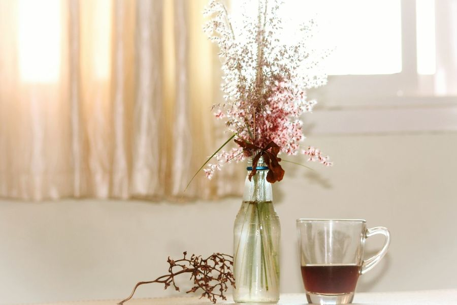 Table Tilted Table Aromatherapy Flower Arrangement Flower Window Springtime Motiff Spring Motiff Spring Theme Coffee Time Sunlight Freshness Airy Water Pastel Colours Soft Colors  Softness Calm Relaxing Moments Minimalism Copy Space Stress Free