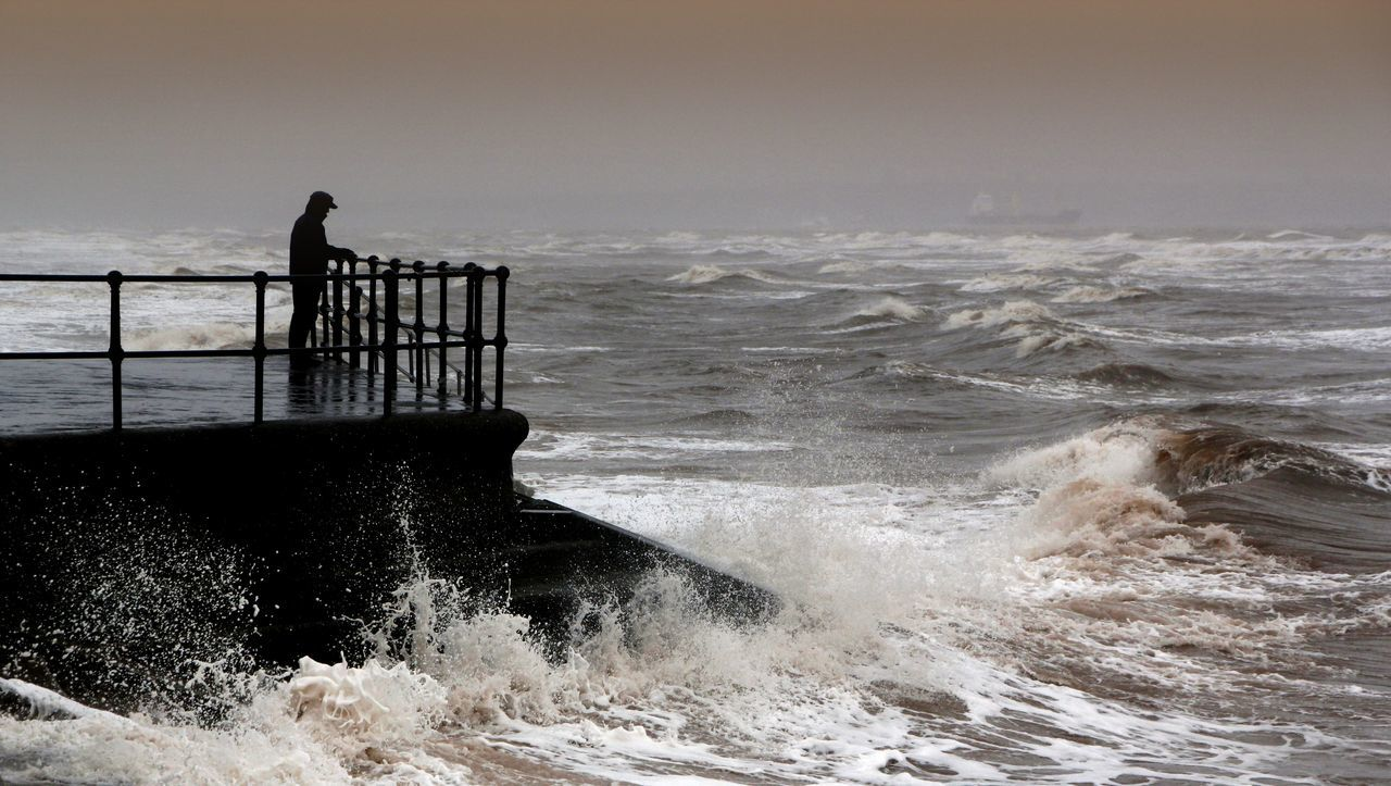 An old man stands in defiance as the storm driven waves pound the seawall Alone Beauty In Nature Day Defiance Defiant England, UK Horizon Over Water Motion Nature No People Outdoors Power In Nature Rough Wave Scenics Sea Seawall Sky Solitary Stormy Weather Water Wave