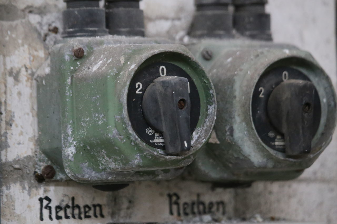 Close-up Dusty Electricity  Historical Metal Old On The Wall Switches Twin Switches Worn Out