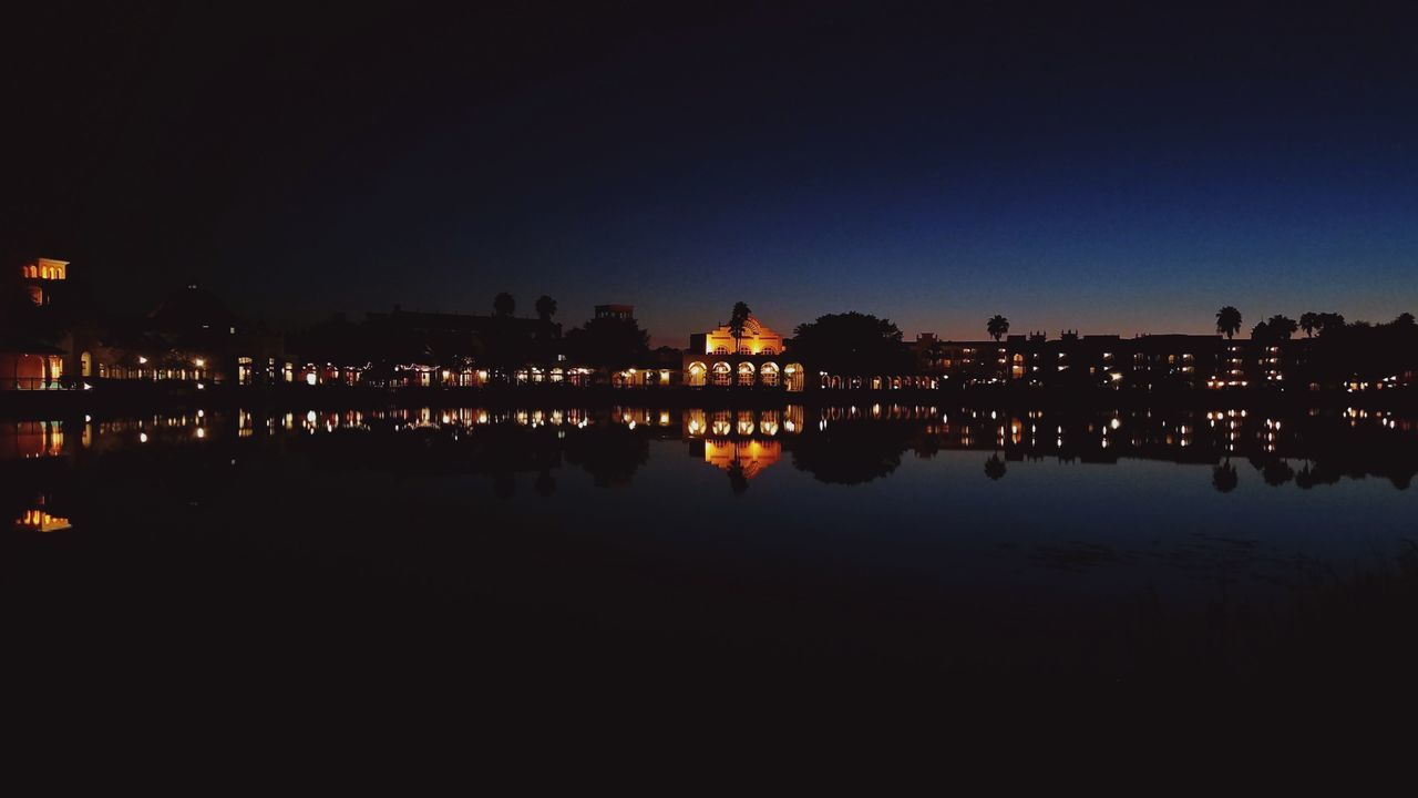reflection, night, illuminated, water, architecture, built structure, silhouette, building exterior, sky, outdoors, no people, clear sky, nature, beauty in nature, city