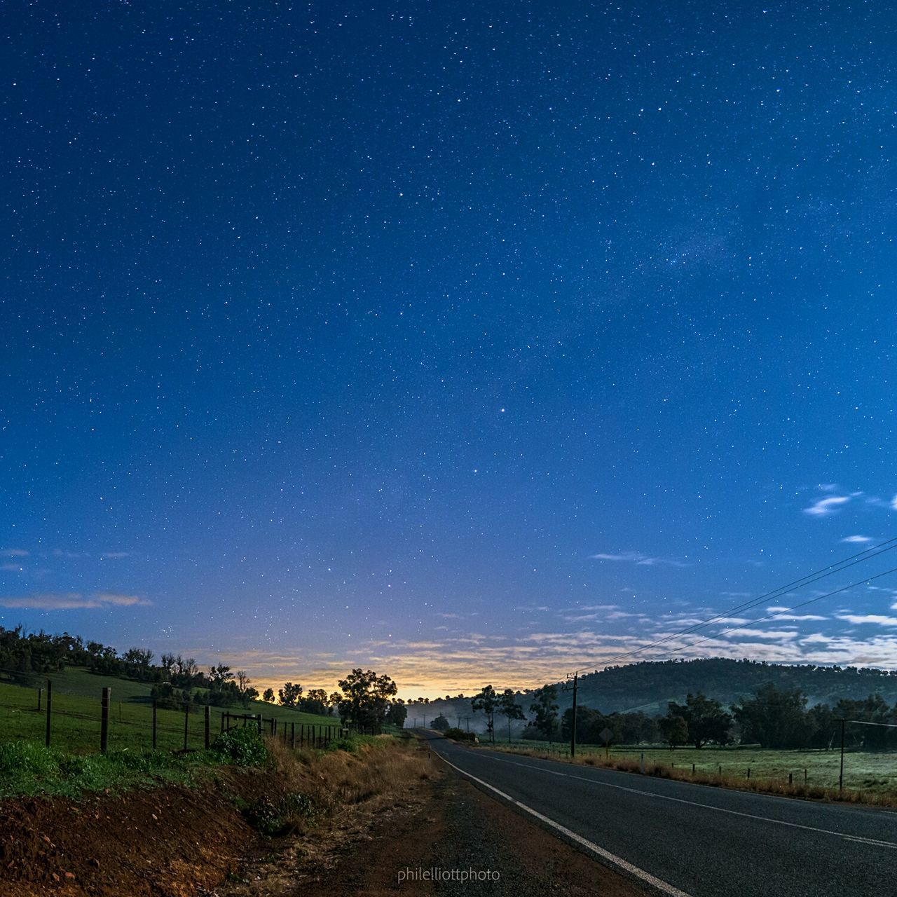star - space, the way forward, infinity, nature, astronomy, beauty in nature, tranquil scene, scenics, night, tranquility, landscape, road, no people, outdoors, transportation, sky, blue, galaxy, space