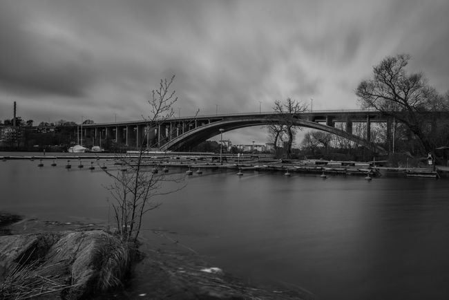 Traneberg. Architecture Art Black And White Blackandwhite Bridge - Man Made Structure Built Structure Cloud Cloud - Sky Cloudy Connection Day Engineering Fine Art Nature Niklasskur No People Outdoors Overcast Popular Photos River Sky The Great Outdoors - 2016 EyeEm Awards The Great Outdoors With Adobe Tranquility Water