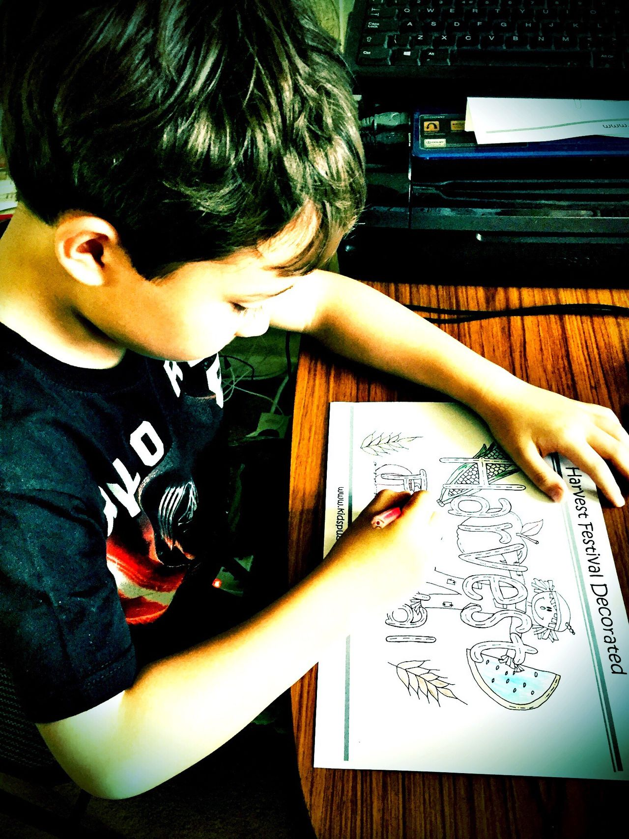 A young boy doing his homework. Boy Child Homework Writing Colouring  Colouring In Art Sat Down