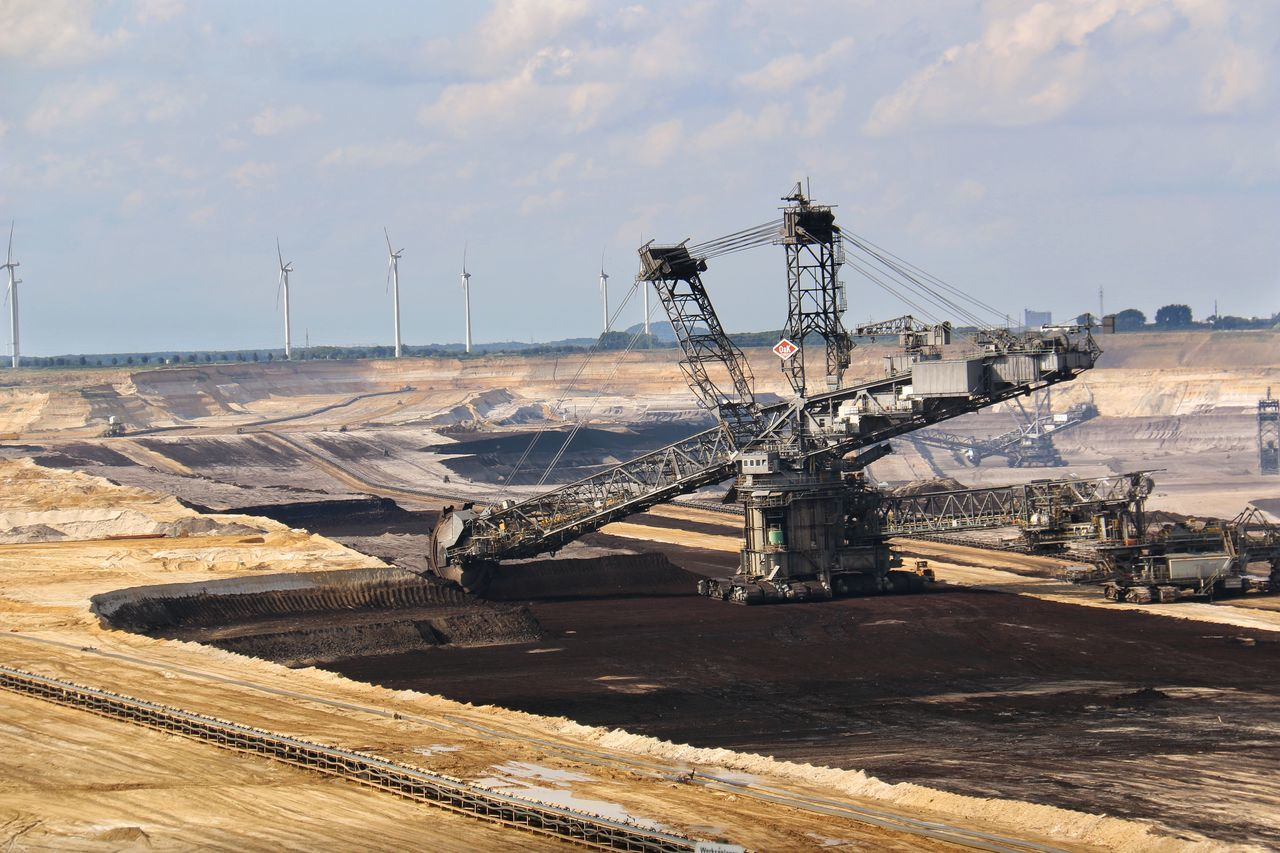 Brown coal surface mining - open cast coal mining. Huge bucket wheel excavator. new developed technology. Supposed to be more environmentally friendly. Bucket Wheel Excavator Cloud - Sky Coastal Feature Day Nature No People Non-urban Scene Open Cast Coal Mining Outdoors Scenics Sky Sunlight Tourism Travel Destinations