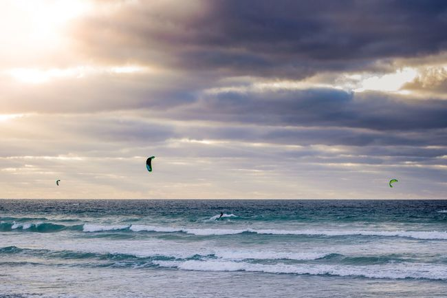 A few kitesurfers as the sun was setting. Famara Lanzarote Sea Water Nature Beauty In Nature Sky Horizon Over Water Cloud - Sky Beach Scenics Outdoors Sunlight Lifestyles Kiteboarding Tranquility Day Extreme Sports Sport Adventure Real People Parasailing Kitesurfing