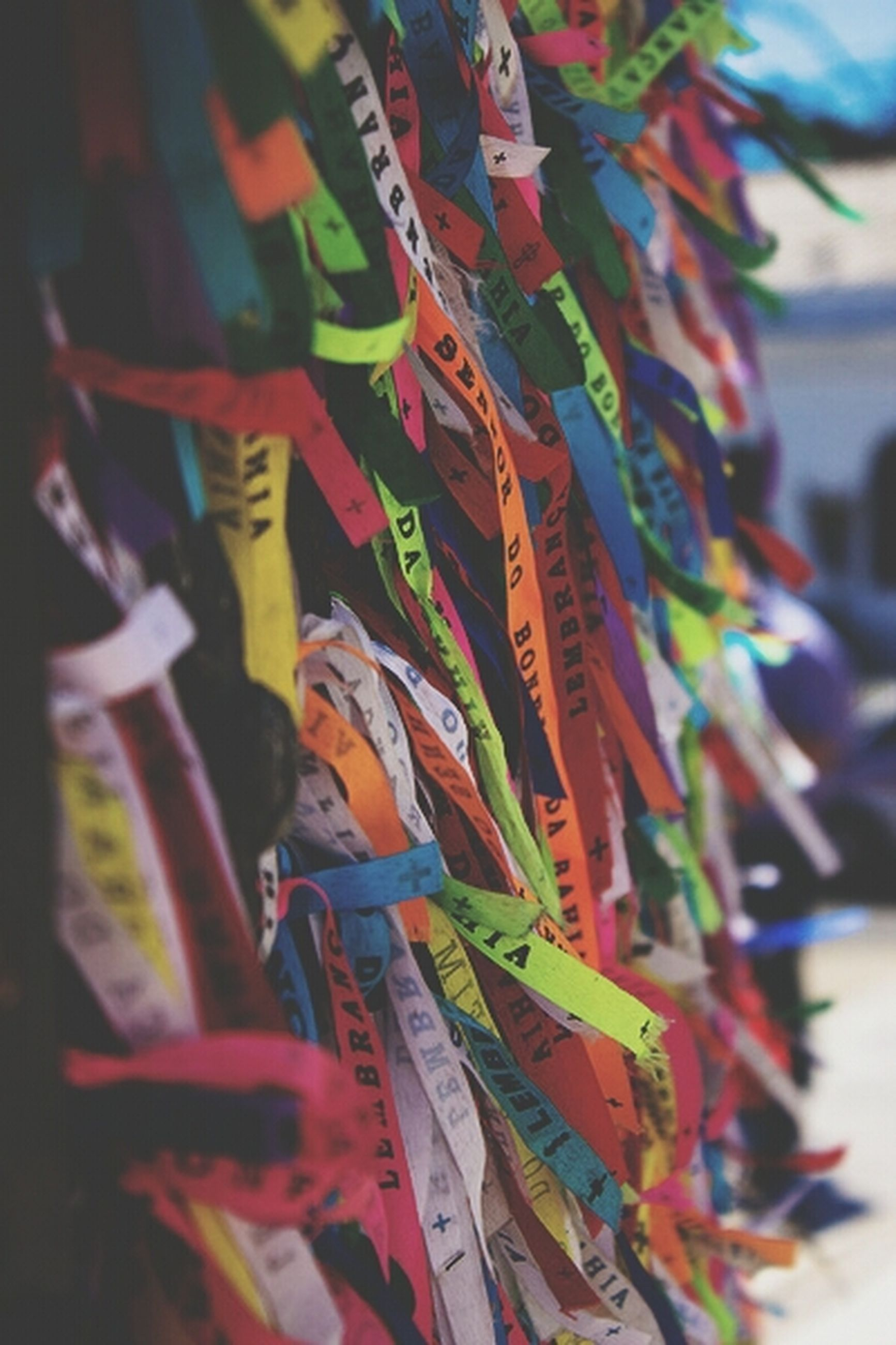 focus on foreground, multi colored, close-up, hanging, selective focus, abundance, large group of objects, variation, for sale, in a row, day, choice, no people, retail, outdoors, art and craft, market, colorful, market stall