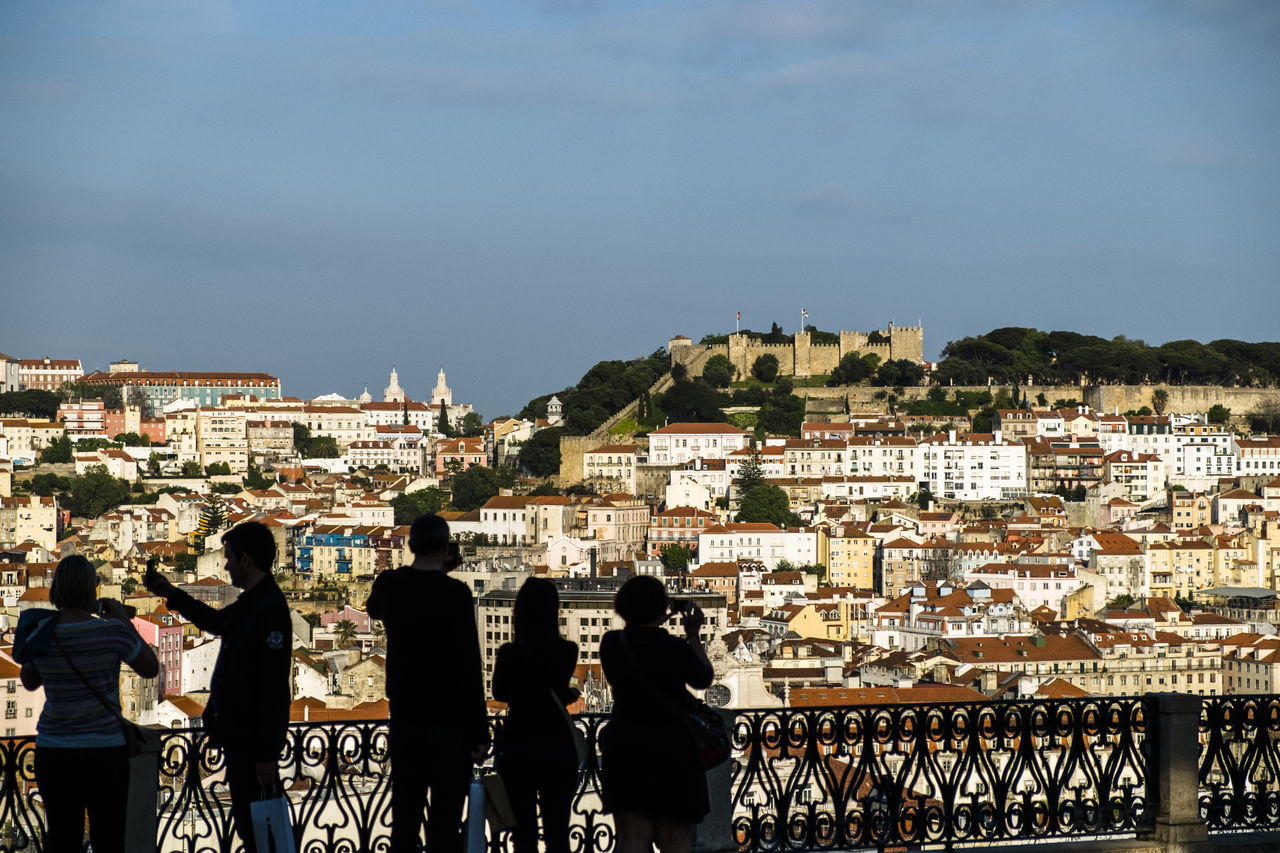Rear View Of People Standing At Observation Point Against Castelo Sao Jorge