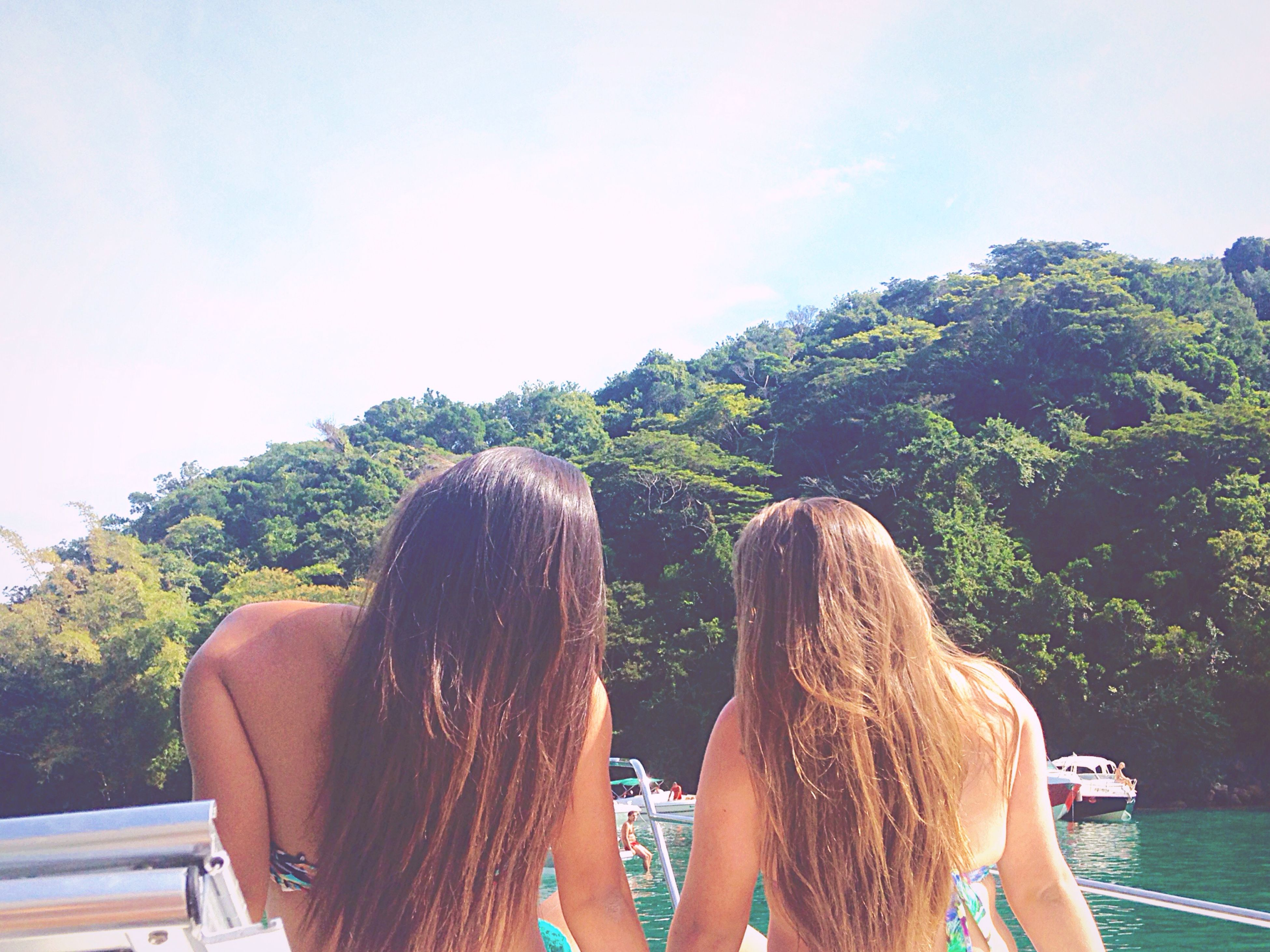 lifestyles, tree, leisure activity, person, long hair, rear view, young women, headshot, young adult, togetherness, sky, waist up, water, nature, vacations, day, men