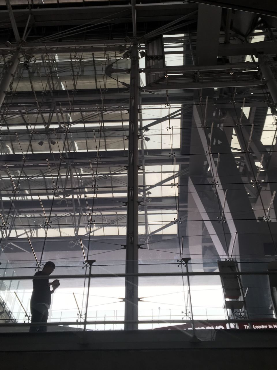 built structure, architecture, indoors, one person, real people, full length, standing, silhouette, day, men, building exterior, people