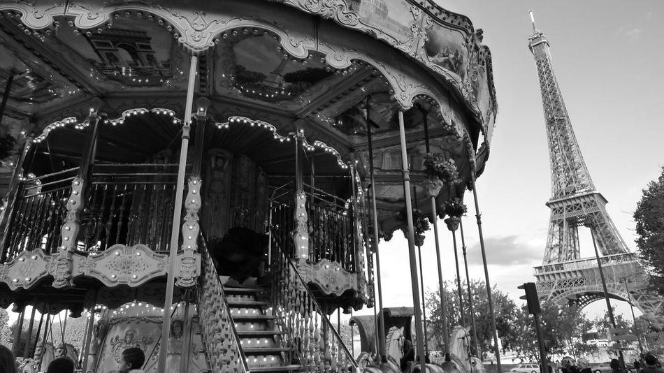 Amusement Park Amusement Park Ride Architecture Arts Culture And Entertainment Blackandwhite Building Exterior Carousel Day Eiffel Tower No People Outdoors Paris Sky