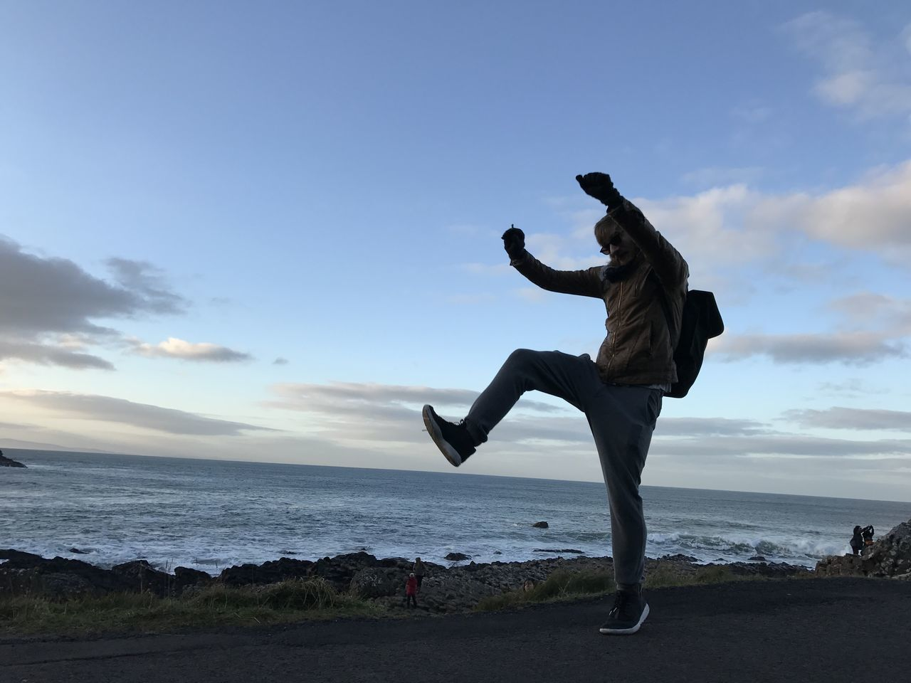 sea, full length, horizon over water, beach, sky, energetic, water, one person, men, motion, jumping, leisure activity, real people, mid-air, nature, agility, outdoors, young adult, lifestyles, day, handstand, flexibility, breakdancing, people