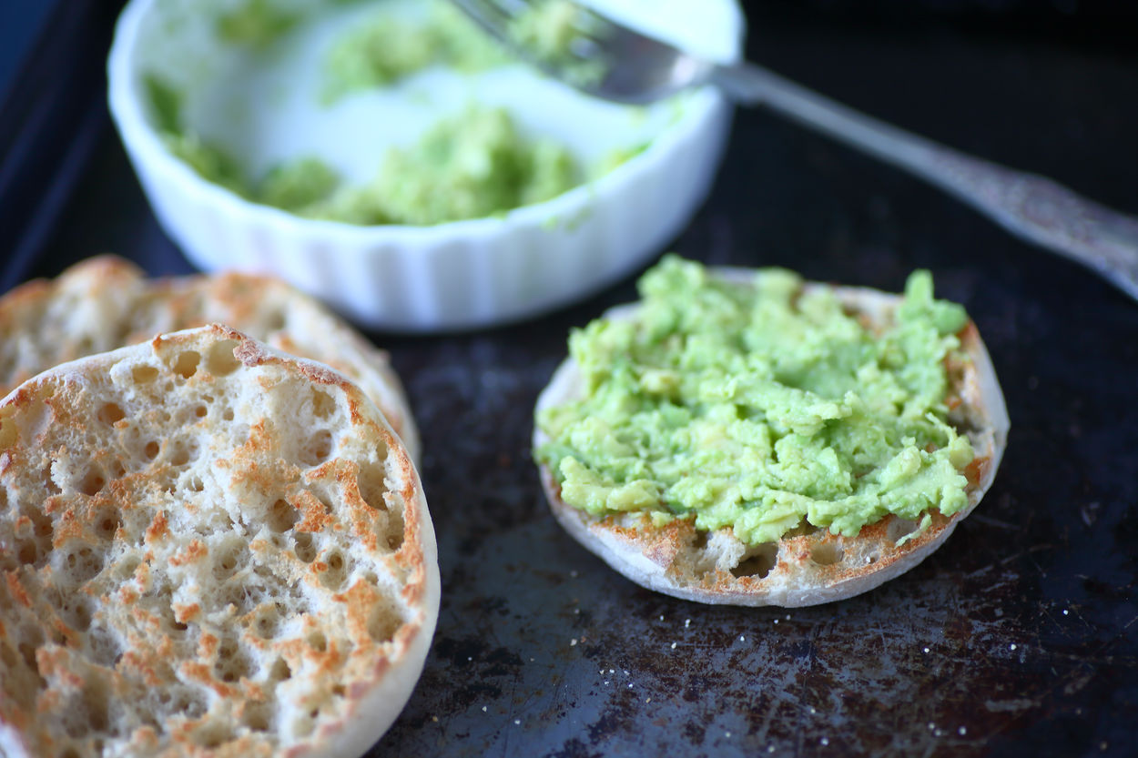 Avocado toast snack Avocado Toast  Beige Tones Close-up Copy Spsace Day English Muffins Food Preparation Fork Freshness Green Healthy Eating Home Food Indoors  Metal Pan Natural Light No People Ready-to-eat Round Snack Studio Shot Textures Toasted Bread White Dish