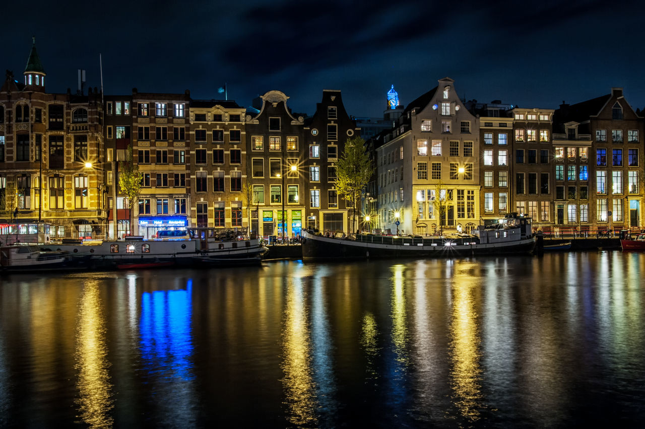 Amsterdam cityscape w/ long exposure Amsterdam Architecture Blue Building Exterior Built Structure City City Holland Illuminated Long Exposure Nautical Vessel Netherlands Night No People Outdoors Reflection Sky Transportation Travel Destinations Urban Water Waterfront
