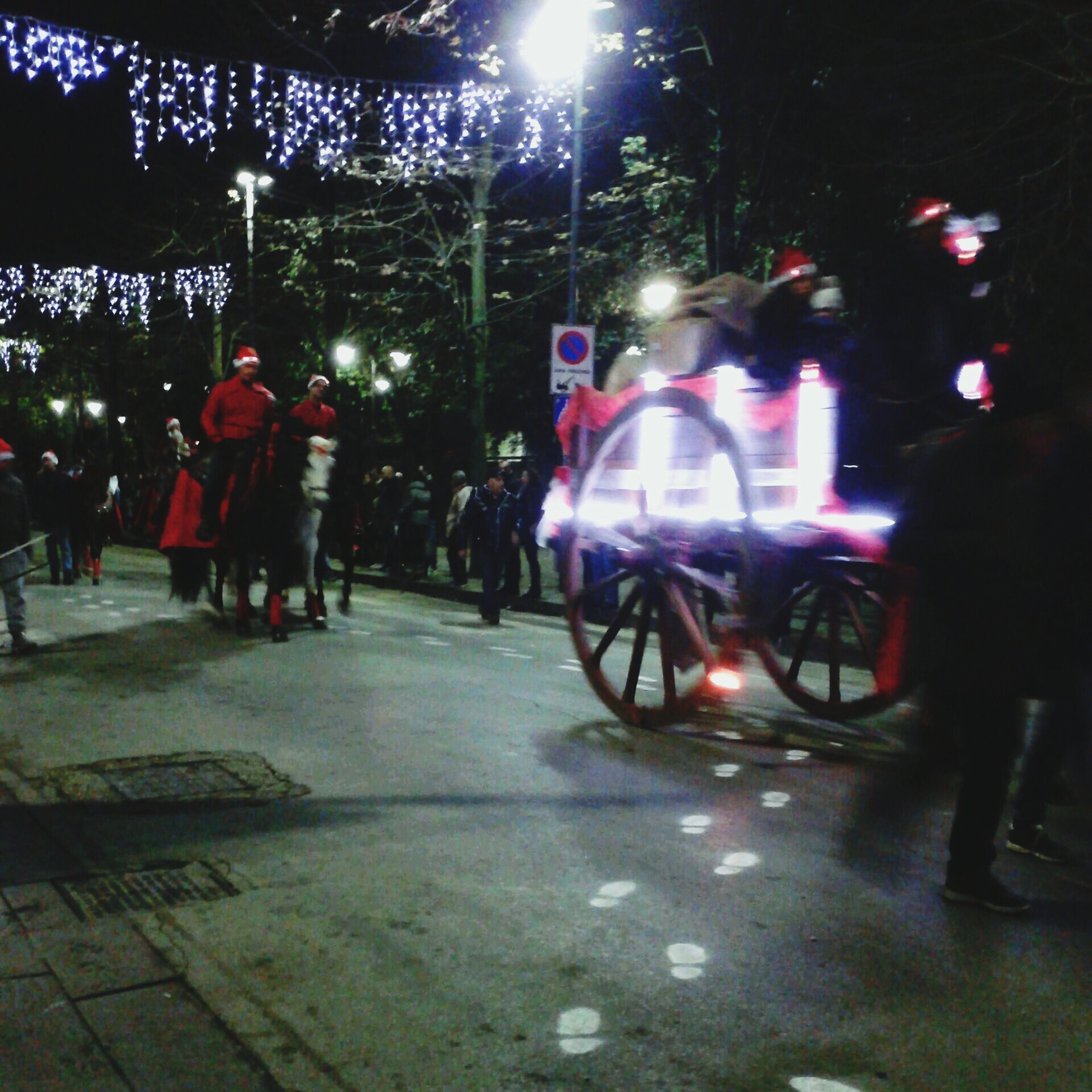 bicycle, transportation, night, street, land vehicle, mode of transport, lifestyles, leisure activity, men, full length, riding, illuminated, road, walking, on the move, shadow, tree, car