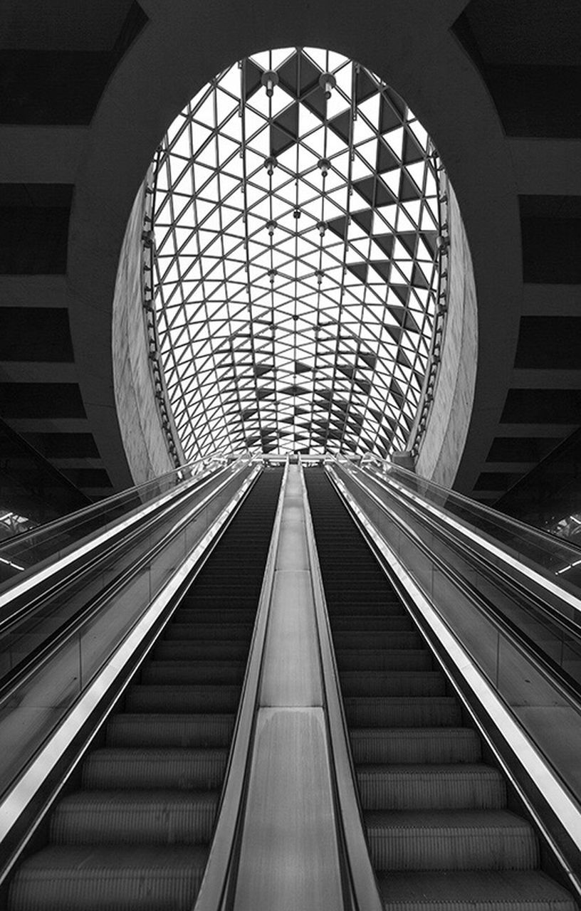 indoors, architecture, modern, built structure, convenience, escalator, technology, futuristic, architectural feature, steps and staircases, staircase, low angle view, illuminated, subway station, day, no people