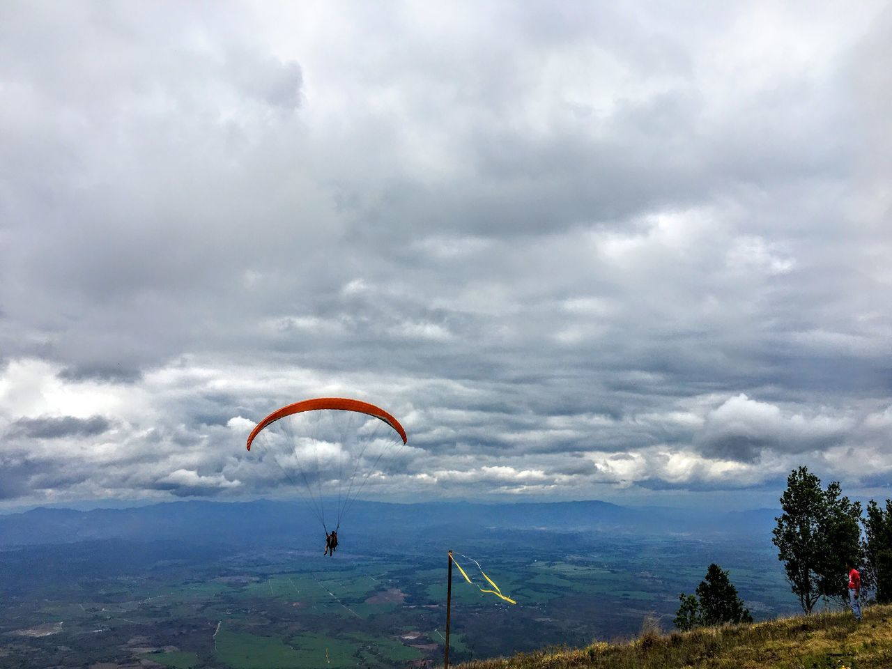 Adventure Extreme Sports Parachute Sky Paragliding Cloud - Sky Leisure Activity Real People Freedom Gliding Nature Lifestyles Landscape Day Mountain Scenics Sport One Person Flying Outdoors Honduras