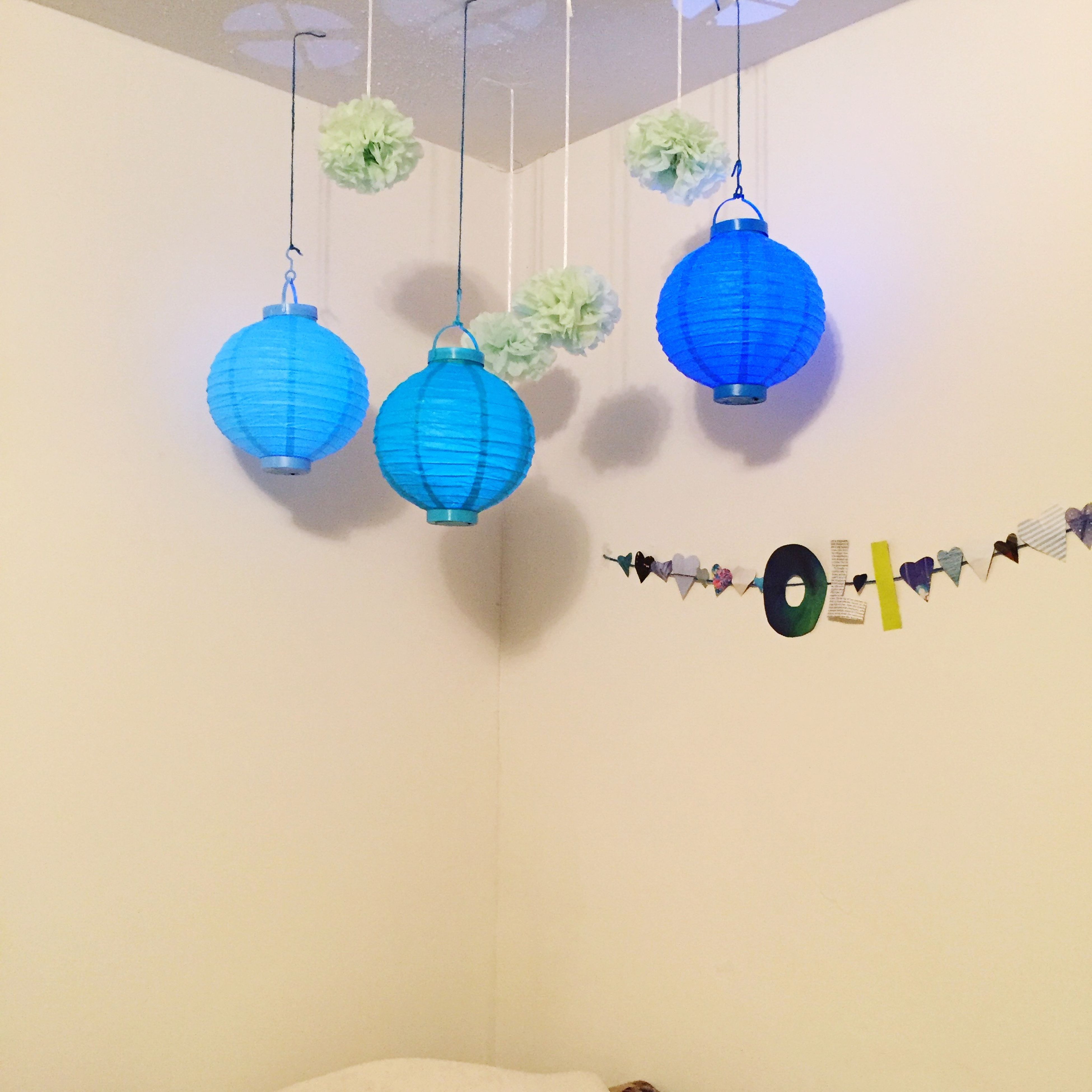 indoors, text, hanging, western script, multi colored, communication, wall - building feature, decoration, lighting equipment, no people, wall, blue, variation, heart shape, close-up, white color, built structure, creativity, paper, in a row