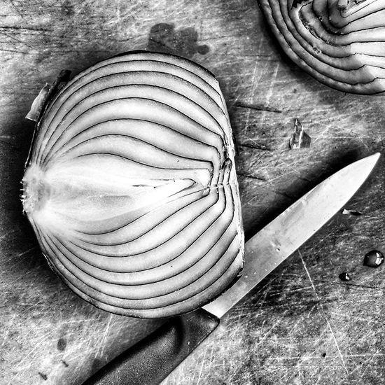 The onion has many layers, black and white Black & White Knife Layers And Textures Texture And Surfaces Textured  Textures And Surfaces Wood B&w B&w Photography Black And White Blackandwhite Blackandwhite Photography Close-up Cut Vegetables Cut Veggies Food Kitchen Art Kitchen Utensils Layers No People Onion Onions Table Vegetable Vegetables