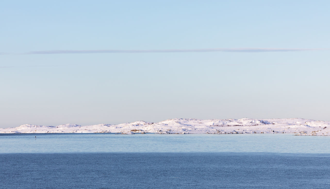 Panoramic view of snowcovered island in sea (natural color blocks and lines) Arctic Beauty In Nature Clear Sky Cloud - Sky Cold Temperature Color Block Copy Space Day Horizon Over Water Island Landscape Lofoten And Vesteral Islands Mountain Range Norwegian Sea Outdoors Panoramic Pastel Colored Remote Scenics Sea Simplicity Snow Striped Waterfront Winter The Great Outdoors - 2017 EyeEm Awards